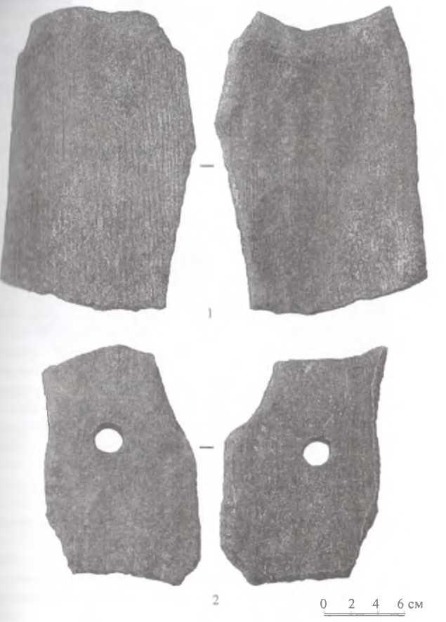 Рис. 5. Городище Тэрэлжин Дэрэвэлжин. Тип II - «желобчатая» черепица с белесым налетом и отверстиями